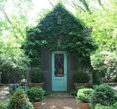 adorable vine covered garden cottage