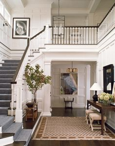 Victoria Hagan wisely kept this entryway very simple, so nothing took away from all that awesome paneling and the sweep of the staircase.
