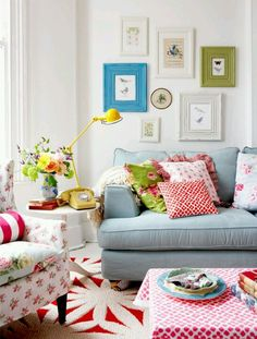 cheerful blue couch  red decor