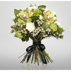 Lime Green    A delicate bouquet of cymbidium orchids, white spray roses, brassica and wax flower