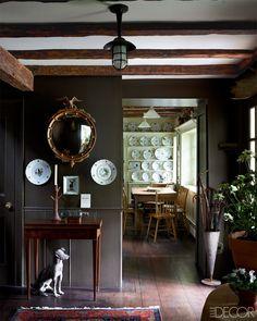 dark walls, wide floor planks, wood beams