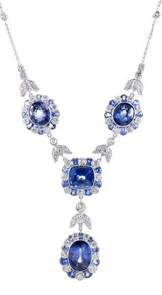 "Platinum Sapphire  Diamond Cluster ""Y"" Necklace.  Edwardian-inspired styling, with four large sapphires, surrounded by clusters of alternating bezel-set sapphires and diamonds, connected by tulip-shaped diamond segments. This necklace looks quite important, yet has not lost its feminine charm."