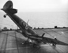 A Supermarine Seafire nosed over on the flight deck of HMS Smiter after a landing accident, 1944.
