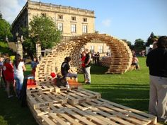 What do you perceive from this strange wooden pallet installation? Well, this is basically an Olympic installation made in the castle. What we did exactly, we just placed the pallets in a position of one on another in a twisting sequence, and we ended up making this incredible pallet wood installation.