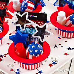 Party favors in red, white and oooooh! Mini stars-and-stripes top hats make fun 4th of July favor containers.