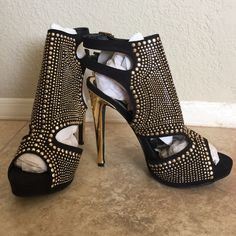 """Black heels with gold stud accents Brand new black heels with gold studs. Never worn, love them but they didn't fit and I couldn't return them. Black faux suede, gold studs and heel is gold as well. Would be the perfect """"going out"""" heels! Shoes Heels"""
