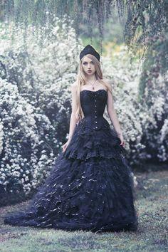 Model, photo: Absentia corset: Corsetry & Romance skirt, headpiece: Veil