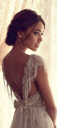 Gorgeous vintage detailing. Also, it's not stiff like so many wedding gowns that have lots of beadwork. You need to be able to move and sit and pose for pictures on your wedding day. Make sure you're comfortable too!