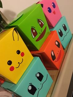 Pokémon party favors I found this boxes at party city, they come in many colors. I used permanent markers to draw Pokémon faces.