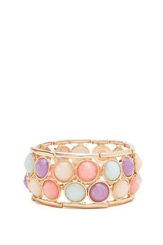 A cute, candy coated stretch bracelet featuring faceted cab stones. High polish finish. Stretchy. $10.50