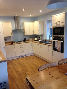 Blue and ivory/cream kitchen with Amtico flooring