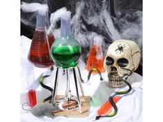 """Get your new 2017 Mad Lab Kit. This Halloween transform your home into a spooky mad scientist laboratory and fill your guest with """"ooze"""" and ahhs! This Mad Lab kit has all the props you need to create an unsettling workshop filled with experiments so dark they would impress even the most infamous of mad geniuses. The Halloween prop kit includes a small bottle, a medium bottle, a large bottle, test tube, burner with PVC tube and stand. Also included is 0.3 oz. spider web material with spider…"""