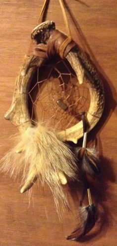 Deer antler dream catcher coyote fur tigers eye rooster feathers buckskin