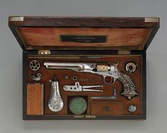 Cased Colt Model 1862 Police Revolver, serial no. 9174, with Thuer Conversion for Self-contained Cartridges, and Accessories  Samuel Colt  (American, 1814–1862)    Steel-chiseler:      Decoration attributed to Louis D. Nimschke (American, New York, active ca. 1850–1900)  Maker:      Case made by Schuyler, Hartley and Graham (American, New York, 19th century)  Date:      1862  Met