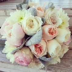 Bridal bouquet of assorted roses, garden roses, peonies, dahlias and dusty miller. Created by Fleurt Floral Art,  Chandler, AZ.