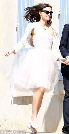 Keira Knightley wore a Chanel couture spring/summer 2006 pale grey tulle, bustier dress, a white tweed jacket created especially by Karl Lagerfeld, Chanel pink and grey ballet pumps and a floral garland