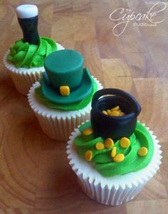 Cupcakes topped with St Patrick's Day themed decorations - Leprechaun hat, pot of lucky gold and, of course, a pint of Guinness!