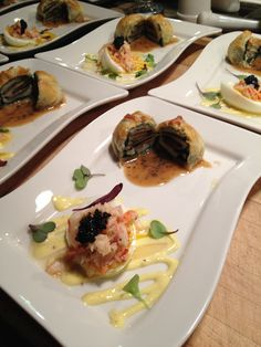 Sea scallops in black tie, stuffed w/ truffles wrapped in spinach in a puff pastry, w/truffle sauce and Decadent deviled egg- with lobster and caviar & truffle oil, over mustard Aioli