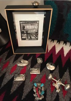 End table with silver boxes and jewelry on Navajo rug