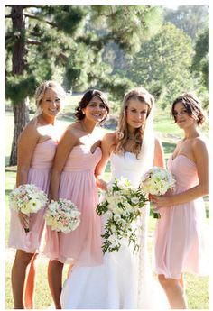 Love the color and style of the bridesmaids dresses