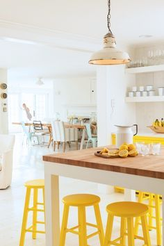 Butcher block island, yellow stools, industrial pendant #kitchen #cottage #capecod