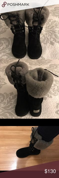 BlackUggs W/ Metal plate tag @ heel size-6 Tall Black Uggs with silver metal plate that says Uggs @ each heel , lined with the traditional fur in gray with leather laces in the front , so warm, comfy & on trend , boots have been worn but very well taken care of , fur lining is a little pushed down but doesn't take away from the warmth @ all , would keep them but a little 2 small & I have another black pair . UGG Shoes Winter & Rain Boots