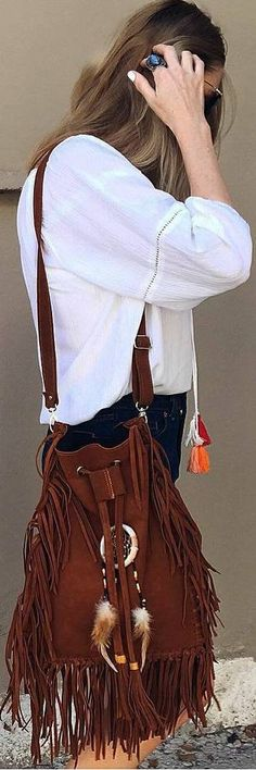 This oversized suede bucket bag comes in a rustic shade of brown and features fringe tassels on the side. The dreamcatcher in the middle adds a hippie touch to this large bucket bag that can carry eve Hippie Bags, Boho Bags, Bohemian Style, Boho Chic, Unique Braids, Bohemian Hairstyles, Fringe Bags, Casual Bags, Bucket Bag