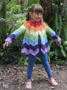 """A lacy chevron patterned jacket to fit newborns to 4 year olds. The pattern is easy to learn, but the sizes are written separately, and in full, to make it more user-friendly for """"not-so-experienced"""" knitters. A colour chart is also given which can be used as a short cut pattern for experts!Written for rainbow colours as in the modeled pics (age 4 size), but easily adaptable for other colour combinations, by using the accompanying chart. Sample pics show some other options."""