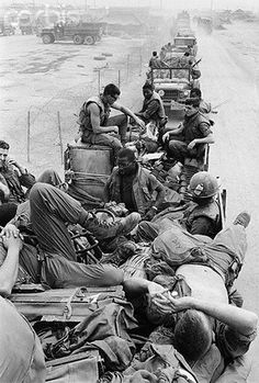 03 Apr 1968, Ca Lu, South Vietnam --- US soldiers from the 1st Cavalry rest on trucks in a convoy before Operation Pegasus, an attempt to clear the east-west route to Khe Sanh during the Vietnam War. --- Image by © Bettmann/CORBIS