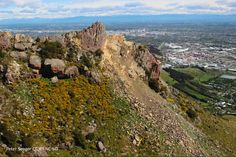 27 October 2012. Castle Rock on the Port Hills with Christchurch Downtown behind.  Taken by Peter Seager CC BY-NC-ND, from the Garden City Helicopter flight