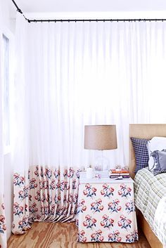 Designer Crush: Alexandra Loew // floral curtains, floral side table, plaid begging