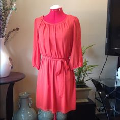 Beautiful tangerine dress Fully lined delicate chiffon dress, 3/4 sleeves with a peekaboo slit, belted. Excellent condition. Summer perfection.019 Sweet Storm Dresses