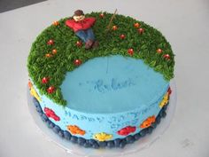 I made this cake for a guy who liked to go fishing. It's a 12 two-layer round cake iced in light blue buttercream to look like water.   The top is decorated
