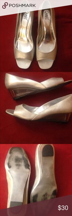 Silver peep toe heels Stunning silver peep toe with clear wedge heel. Carlos Santana brand really comfortable. In excellent used condition. Only sign of wear on soles. Carlos Santana Shoes