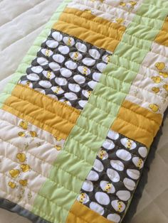 Quick, free baby quilt pattern using charm squares.
