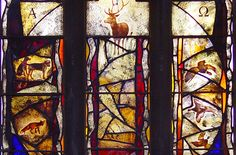 St Helena's Church, Waltham on the Wold detail of stained glass window design by glass artist Derek Hunt with illustrations of animals of the countryside