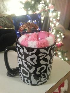 Inexpensive gift around $10 for your sister-in-law or friend! $5 mug, $2 nail polish, $.50 cappuccino mix packet, and $1 fuzzy socks from the dollar store. Place in a cute gift bag with some tissue paper and a few candies at the bottom and wah-lah! :)
