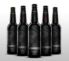 """Designed by Israel Viveros - Khooms is a brand new artisan premium dark ale that is focused on the idea of a dark, strong and simple beer. The main focal point is the illustrative lion to enforce the power of this dark strong beer.""""Khooms is a new brand… Beer Packaging, Food Packaging Design, Beverage Packaging, Premium Beer, Lion Design, Lager Beer, Label Design, Package Design, Graphic Design"""