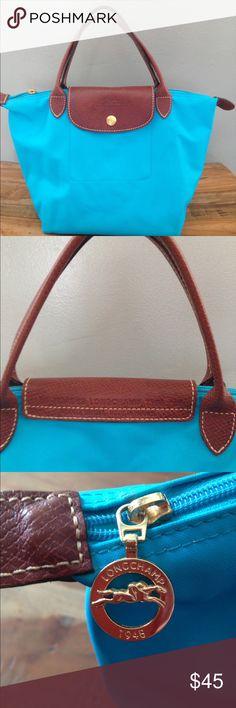 Authentic Longchamp Le Pliage bag Gently used Longchamp bag. Beautiful turquoise color. Longchamp Bags Totes