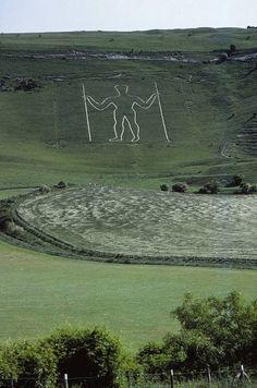Long Man of Wilmington on South Downs Sussex A prehistoric hill figure located in East Sussex England on the steep slopes of Windover...