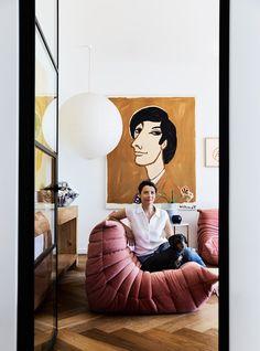 """Rachel cuddles up with Sydney Sausage on her [Ligne Roset](https://www.ligne-roset.com/au/) """"Togo"""" sofa. A large paper shade lights up an or..."""