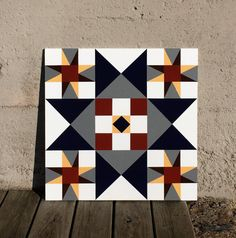 Barn quilt in navy blue, gray, brick red, yellow, dark red and white. This barn quilt would not only look beautiful on a barn but also on your garage or shed! Wood is exterior grade MDO plywood for a smooth finish. Paint is exterior paint suited for outdoor use. Can be made to order in your colors. Please allow 1 - 2 weeks. Size is 2 x 2.