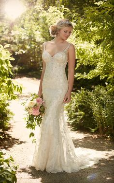 This Essense of Australia mid v-line wedding dress features metallic silver lace swirls, lace over Lavish satin sheath and the bodice is lightly fitted.