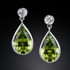 "Peridot and Diamond Drop Earrings: ""Beautiful, high-quality peridot and diamond earrings are rather difficult to come across so occasionally, when we happen upon a worthy matched pair of gemstones, we create them ourselves."" // WANT."