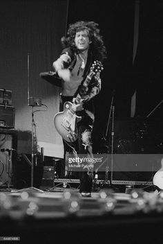 Guitarist Jimmy Page performing with British heavy rock group Led Zeppelin, at Earl's Court, London, May 1975. On the left is Page's theremin. The band were initially booked to play three nights at the venue, from 23rd to 25th May, but due to public demand, two more concerts were later added, for 17th and 18th May. Total ticket sales were 85,000.