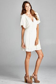 Short loose sleeve dress with lace trim on front and back. $44.00