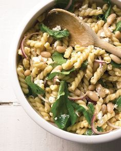 Pasta salad with goat cheese, cannelini beans, and arugula.
