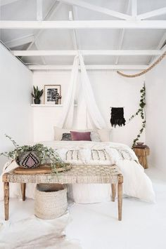 Bohemian beach style bedroom featuring handmade wall hangings