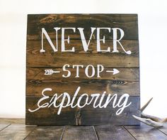 Reclaimed wood finds new life in this custom sign. Each wood sign is fashioned from old pallets and hand-painted with Never stop exploring. Due to
