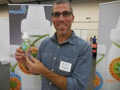 Kerry Ettinger holding a MILKCHARM - a cute and clever breastmilk-freshness tracking system. Eepples.com. Great idea!